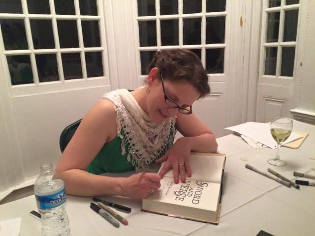 The author hard at work signing guests' copies of SWORD AND VERSE.